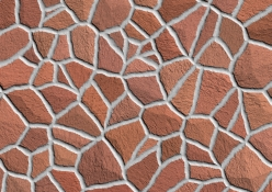 Abstract pattern and texture of stone walkway in red colors.